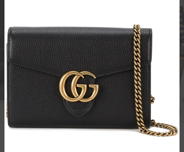 black Gucci sling bag