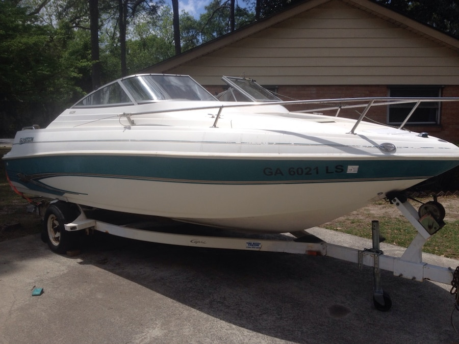 Used white and green motor boat on white boat trailer in for Green boat and motor