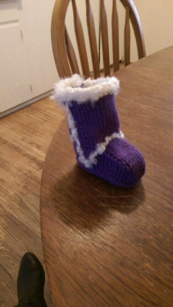 Purple ugh-style knitted booties