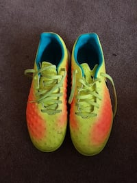 pair of yellow-and-pink Nike cleats Regina