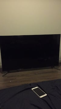 black flat screen TV with remote Los Angeles, 90015