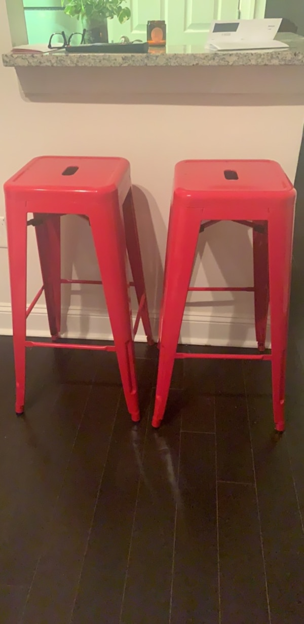 Two red bar stools
