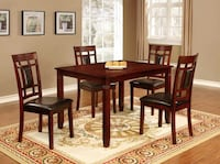rectangular brown wooden table with four chairs dining set Brampton, L6X 4K8