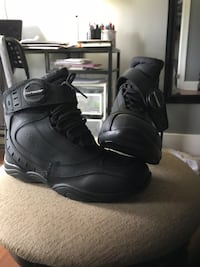 Pair of black tourmaster high-tops