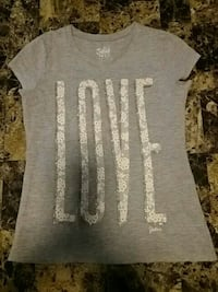 gray crew-neck t-shirt with white love print.