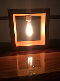 brown wooden frame with bulb