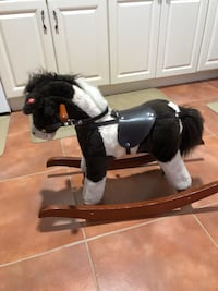 black and brown rocking horse 57 km