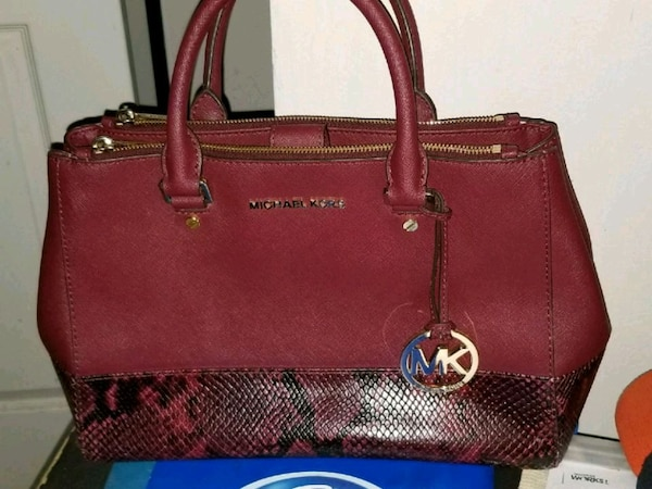 21399153ff88 Used red Michael Kors leather 2-way bag for sale in Detroit - letgo