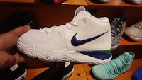 pair of white-and-blue Nike basketball shoes Toronto, M4E