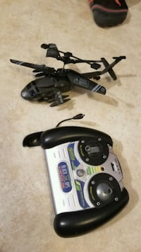 black and gray quadcopter with controller Milan