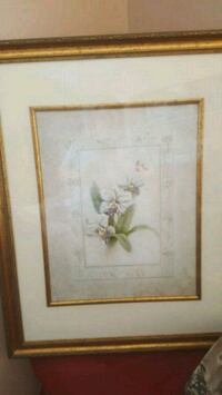 white-and-purple orchids painting and brown frame