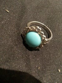 silver-colored blue stoned ring