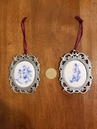 2 pewter and ceramic wall hangings