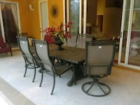 Hard Stone Patio Table With 8 Chairs 2 that spin Orlando, 32836