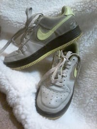 pair of gray-and-green Nike low-top sneakers