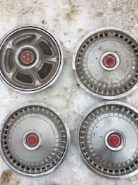 Gray and red automotive hubcaps collectible 909 mi