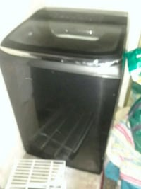 black and gray compact refrigerator 2414 mi