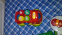 red and green plastic toy Anderson, 29625