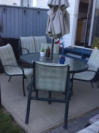 Seven piece patio set in good condition.4 chairs 1 swing table,Bralla and foot rest Spruce Grove, T7X 4B4