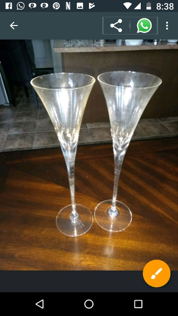 two clear cut wine glasses