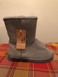 Pair of gray ugg bailey button boots 784 mi