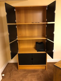 brown wooden TV hutch with flat screen television 469 km