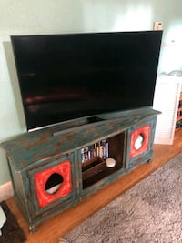 black flat screen TV with brown wooden TV stand Tampa, 33603