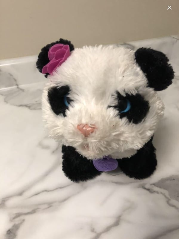 White and black panda plush toy walking  b14c9718-2679-45ce-95a1-4704544316e0