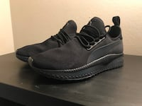 Pair of black-and-gray running shoes Los Angeles, 91606