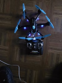 black and blue quadcopter with controller Lansing, 48933