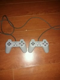 two gray Sony game controllers Mississauga, L5L