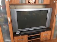 gray CRT TV with brown wooden TV hutch 5 km