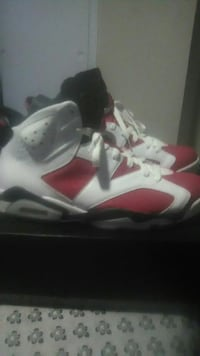 white-and-red Air Jordan 7's basketball shoes
