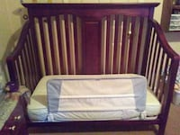 baby's brown wooden crib Manchester, 03103