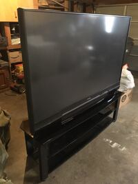 black flat screen TV with remote control Moreno Valley, 92553