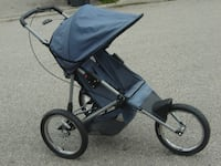 """MUST GO TODAY ONLY $75.00 FIRM OVER A YEAR OLD 16"""" AIR WHEELS INSTEP JOGGER STROLLER! Mississauga"""