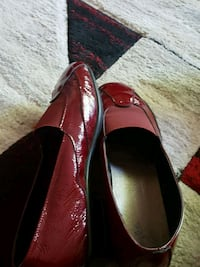 pair of red leather pointed-toe flats Calgary, T1Y 6J7