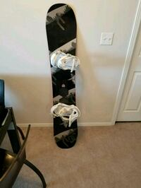 white and black snowboard with bindings Calgary, T2G 5R1