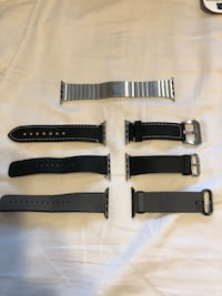 three assorted watch straps and silver-colored watch link bracelet