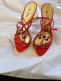 pair of red leather open-toe heels Calgary, T3J 3C8