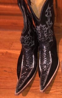 pair of brown leather cowboy boots Denver, 80223