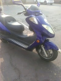 blue and black motor scooter 2388 mi