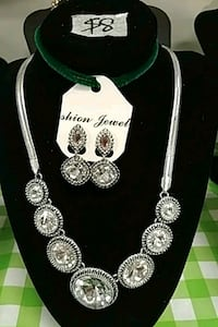 silver necklace and earring