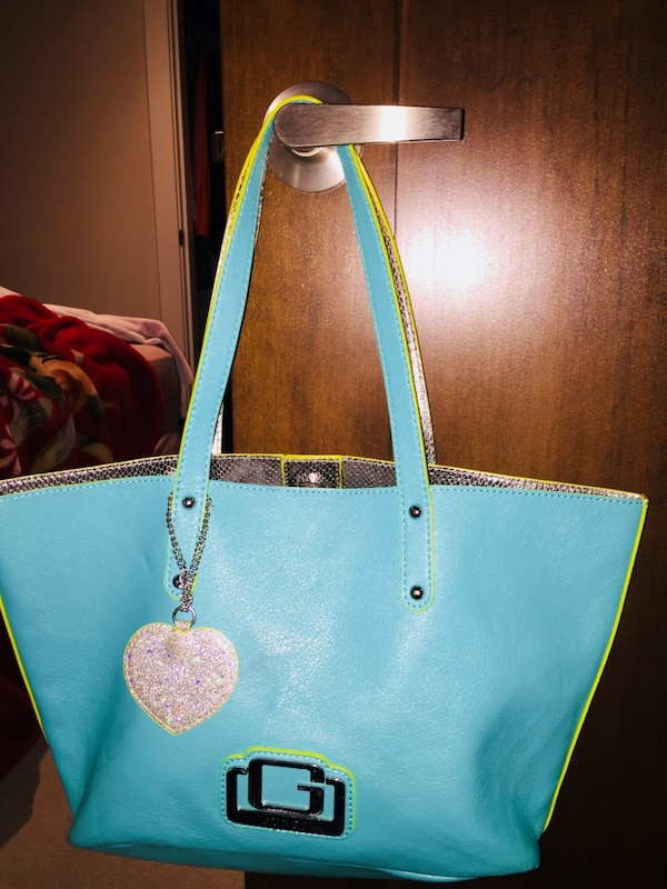 Teal and yellow guess leather tote bag