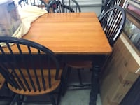Brown and black wooden table with 6 chairs