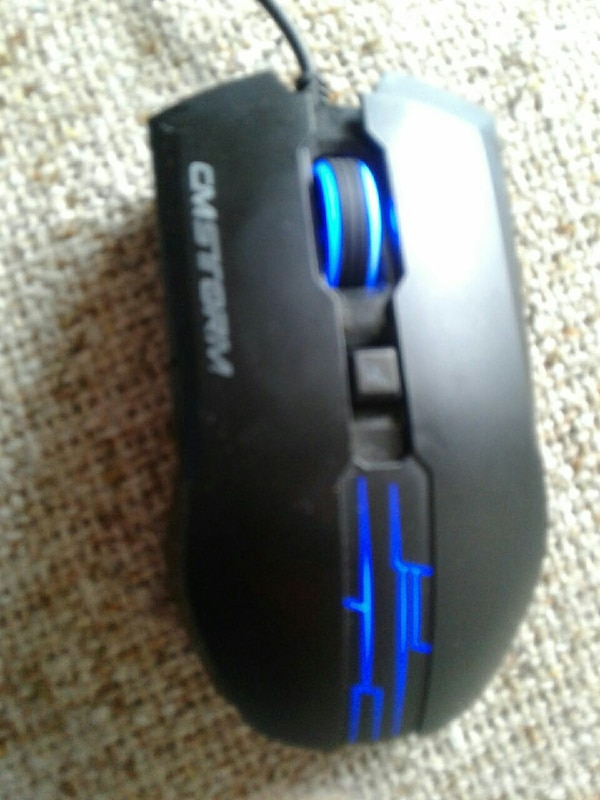 blue and black CMSTORM corded gaming mouse