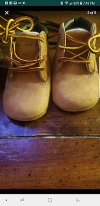 pair of toddler's brown leather boots screenshot
