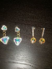 two pairs of gold encrusted diamond dangling earri Vaughan