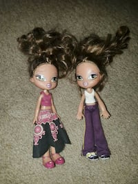 two Barbie doll in purple and black dress Hope Mills