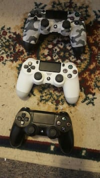 two black and white Sony PS4 controllers Maryland